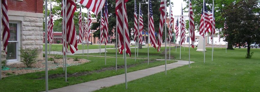 Flags around small town courthouse on Memorial Day